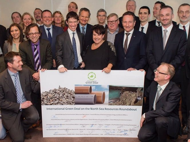 Defra resources minister (centre) holds up the North Sea Resources Roundabout deal alongside other signatories from France, Flanders and the Netherlands